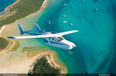 Rick Gardner and Anton Leonhardes fly Rick's Cessna 337 over the clear waters of The Bahamas.