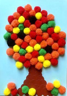 Bricolage facile pour l'automne : un arbre en pompons ! Quelques jolis pompons aux couleurs automnales et des gommettes rondes marron : le tour est joué, un arbre d'automne est né !