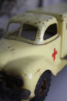 Vintage yellow toy ambulance. Photo by Elsa on Flickr  taken on December 5, 2010 using a Canon EOS 1000D.