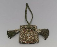 English, 1610–50       England Dimensions     Overall (without tassels and cord): 6 x 6 cm (2 3/8 x 2 3/8 in.) Medium or Technique     Silk; satin embroidered with silk, gold metallic thread, seed pearls, spangles, metal purl, and colored glass; silk and metallic braided cords and handle; two tassels