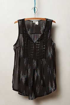 great tank for going out...wear now under a leather jacket and into spring with white jeans