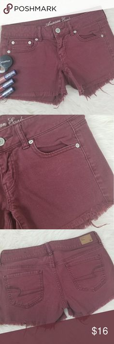 America Eagle cut off shorts size 4 Super cute American Eagle stretch size 4 cut off shorts. Beautiful fraying edges in a perfect condition definitely a must have this Spring and summer.  Beautiful wine red in color would be super cute paired with a white crop top! A03 American Eagle Outfitters Shorts