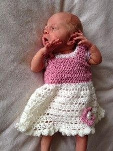 little crochet dress for a newborn. Links to lots of patterns on the same pg.