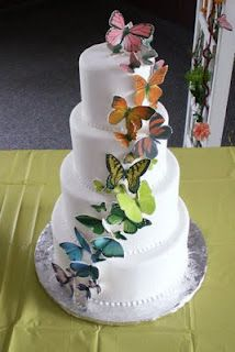 butterflies cascading on four tear cake