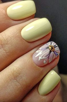 pastel yellow with flower on the ring finger, perfect for a garden wedding