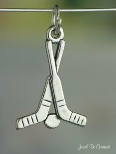 Hockey Charm Sticks and Puck Sports Equipment Sterling Silver. $5.95, via Etsy.