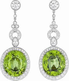 A Pair of Peridot and Diamond Ear Pendants. Photo Philips de Pury & Company Each suspending an oval-cut peridot, weighing. Peridot Jewelry, Gemstone Jewelry, Jewelry Box, Jewelry Accessories, Fine Jewelry, Jewelry Design, Purple Jewelry, Grenade, Diamond Earing
