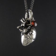 "Valentine Necklace - Anatomical Heart Necklace with Sterling Silver Wire Wrapped Garnet - Anatomical Heart Pendant on 24"" Gunmetal Chain on Etsy, $80.00"