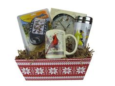 Need a quick present for a winter birthday? Christmas? Hanukkah? This unique gift basket makes the perfect surprise for the bird lover in your life. A Mark Feldstein wall clock, the Identiflyer Lyric, a stainless steel Goldfinch travel mug and American Expedition stoneware coffee mug are nestled inside a decorative basket.