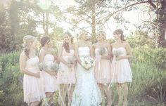 Bridesmaids in knee-length pastel pink dresses | Vintage wedding photography | www.newvintagemedia.ca