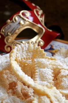 Frappe or Cioffe are traditional Carnevale Italian bow tie cookies, to describe them easily. The fried, slightly sweetened dough turns as light as angel wings and tastes heavenly, especially with a dusting of powdered sugar!