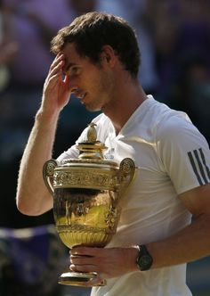 Andy Murray holds the Wimbledon trophy after defeating Serbia's Novak Djokovic in the men's final. Photo: Jonathan Brady/PA Wire