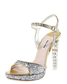 Glittered Leather Platform Sandal by Miu Miu . If you didn't know ..  Miu Miu, from Miuccia Prada, made its debut in 1993, and the offshoot of core collection Prada has become a star in its own right! Miu Miu is an outlet for Ms. Prada's avant garde imagination. The collection includes ready-to-wear, shoes, handbags, and accessories.