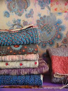 Unfinished vintage quilts. I feel I should gather them up and finish them.