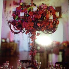 Using these for center pieces but with white hydrangea with the red accents! I am in love!