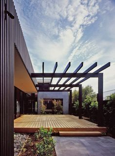 Large scale pergola that connects the deck wonderfully to the house