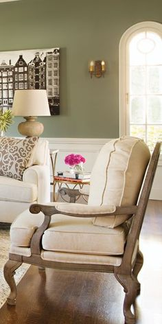 The hardwood frame and beige linen cushions of the Elsa Accent Chair are perfect for a traditional style. Shop online now. #LivingSpaces