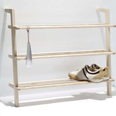 Single image of the Shoe Cabinet Gaston with Shoehorn by side by side. The shoe cabinet provides space for ca. 9 pairs of men's shoes or 12 pairs or women's shoes and consists of untreated massive ash wood. Rack Design, Design Shop, Small Furniture, Furniture Design, Shoe Storage Solutions, Entryway Shoe Storage, Shoe Shelf Diy, Regal Design, Shoe Cabinet