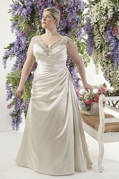 """""""This Callista dress has it all: ruching, an A-line silhouette, and gorgeous beading. I would be hard-pressed to find a bride this dress didn't flatter!"""""""