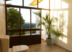 The bathroom from Studio Laranjeira. Showering with an amazing view!
