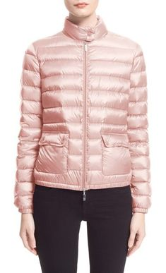 'lans' water resistant short down jacket by Moncler. Exceptionally lightweight direct-inject down-and-feather fill insulates a classic channel-quilted puffer designed with a sporty, fitted profile. The water-repellent nylon construction is finished with a wind-blocking snap-tab stand colla... #moncler #jackets #outerwear