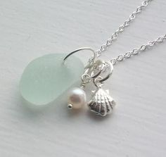 sea glass necklace...picturing this with a silver starfish charm instead of a seashell.