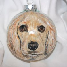 The ornament that Sherry Kendall, of Wagging Tail Portraits.com, painted for Oprah of her little Sadie.