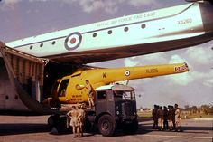 A Bristol Sycamore XL825 being loaded into Blackburn Beverley XB260 at Seletar Airport, Singapore. 1960's