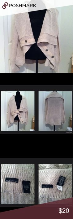 """Moda Int'l/ Victoria's Secret Beige Cardigan Moda Int'l/ Victoria's Secret Beige Cardigan     Beige cardigan.  Shawl type collar and snaps up the front.  Slightly longer in the back.  Size XL – 24"""" armpit to armpit.  I would say this has a slightly oversized look to it; not meant to be skin tight.  Good used condition.  Does have very minor pilling so priced accordingly (so minor I really couldn't capture in a picture); however, no stains, snags or tears.  With a little effort, the pilling…"""
