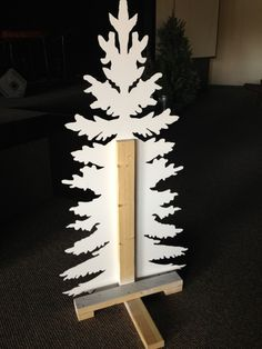 Inspired by a wood, laser cut tree spotted at a retail clothing store, they snapped a picture and gave it to their lead graphic designer who. art design landspacing to plant Christmas Stage Design, Church Stage Design, Christmas Photos, All Things Christmas, Christmas Crafts, Christmas Decorations, Christmas Ornaments, Church Decorations, Christmas Trees