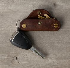"Italian Leather Key Cover - example of gorgeous, ridiculous conspicuous consumption of unnecessary, ""practical"" possessions... ""Designed for journeys near and far, epic and everyday, our Italian leather accessories are as luxe as they are practical. Crafted with care by a 150-year-old Italian tannery, each is made from the finest English hides, chosen for richness and character."""