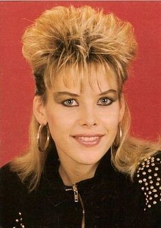 C.C. Catch in a mullet. I love the eye-makeup