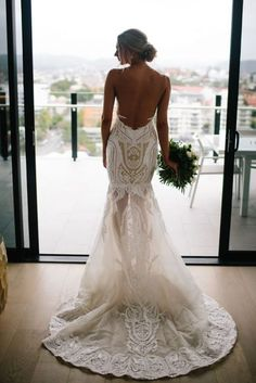 The lace Wedding dress this bride wore in her stylish Australian wedding is simply gorgeous. See more of this stunning bridal gown by clicking on the photo - #weddingdress #weddingdresses #bridalgown #bridal #bridalgowns #weddinggown #bridetobe #weddings #bride Photography: Prue Franzman