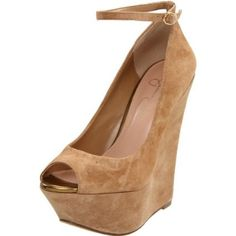 she needs to stop designing her shoes for short people... i could NOT walk in these but theyre so cute!
