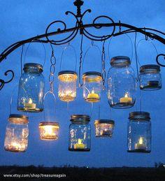 Hanging Mason Jars Lids 10 DIY Hanging Lantern Lids by TreasureAgain, via Flickr