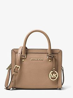 5ba48f5ef705 Crafted from pebbled leather and punctuated by gold-tone hardware, this  handbag boasts a logo-lined interior with room to stow your phone, ...
