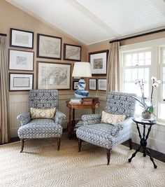 armchairs in reading corner of country bedroom in ocean blues, greens and white, vintage and antique furniture, gallery wall of maps, Nova Scotia guesthouse by designer Philip Mitchell