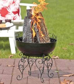 """This Black Scroll Fire Pit and Wood Rack will warm up any occasion. The black scrollwork on each piece provides a decorative accent that can be left out in the elements. Use the Fire Pit (10"""" dia. x 16-1/2""""H) for backyard gatherings or take it camping. It converts into a grill in seconds with the included cooking grate that securely attaches to the top. #firepits #outdoorfire #fireplaces #smallfirepits #outdoors"""