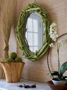 DIY Twig Mirror via Elle Decor. Turn a yard sale find into an eco-chic mirror. Mirror Makeover, Diy Mirror, Driftwood Mirror, Oval Mirror, Mirror Ideas, Foyer Mirror, Driftwood Wreath, Mirror House, Sunburst Mirror