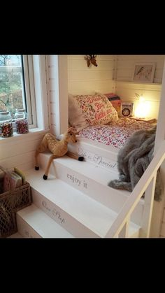 The stairs and shelf above bed