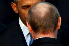 Photos of the day - November 15, 2015 U.S. President Barack Obama (L) talks with Russia's President Vladimir Putin as they gather for a family photo with fellow world leaders at the start of the G20 summit at the Regnum Carya Resort in Antalya, Turkey, November 15, 2015. (REUTERS/Jonathan Ernst)