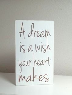White and Brown Disney A Dream Is A Wish Your Heart Makes Painted Wood Sign. $10.00, via Etsy.