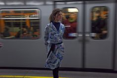 10.15 Miriam Stein is waiting for the Vienna U-Bahn - wearing the A Day in a Life Mountain Printed Silk Chiffon Shirt Dress and the Navy Ribbed Turtleneck Dress
