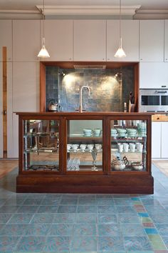 Another view of converted store counter as kitchen island. This is divine! Discover the best interior designers on HOUSE - design, food and travel by House & Garden. A potent cocktail of reclaimed & modern, salvage specialist Retrouvius have a style we covet.