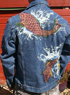 Tattoo Koi Carp Mans denim jacket. Hand painted, bleached  This pre warn, mans denim jacket features 100% tattoo style original art, lovingly hand done by myself. First I bleach the deign onto the jacket and then add the colour and detail by hand, with Faber Castell fabric pens. These are the most durable, light fast and water proof pens I have found. If you wash on a low temperature and treat it well, this unique jacket should last you a life time. Best of all, no one else in the world will…