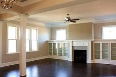 Amazing great room with hardwood floors and built-ins with glass door cabinets.