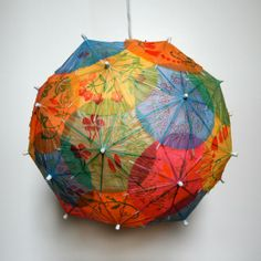"jennadaily: "" This Is Cool, I Want One: Pendant Lamps Made From Recycled Books Etsy artist Allison Patrick makes her artichoke-shaped lamps out of recycled books, road maps, and cocktail umbrellas. Paper Umbrellas, Paper Lanterns, Paper Lamps, Hanging Lanterns, Diy Luminaire, Luminaire Design, Cocktail Umbrellas, Umbrella Lights, Mini Umbrella"