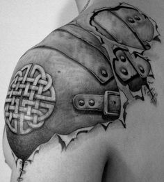 shoulder armor tattoo...awesome on so many levels…my bf would do this, kinda hope he does its hot