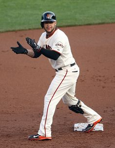 San Francisco Giants' Gregor Blanco (7) celebrates his double against the St. Louis Cardinals in the first inning of Game 4 of the National League baseball championship series at AT&T Park in San Francisco, Calif., on Wednesday, Oct. 15, 2014. (Jane Tyska/Bay Area News Group)