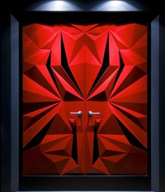 Door design by Dimension Millworks.  Not found on their site, unfortunately.  Consider a Faux paint job...  shades of red would create a similar effect.